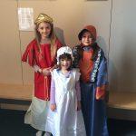 Children enjoying dressing up costumes in Harborough Museum.