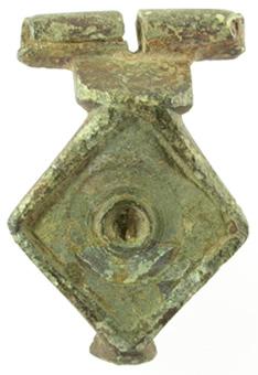 A diamond-shaped brooch